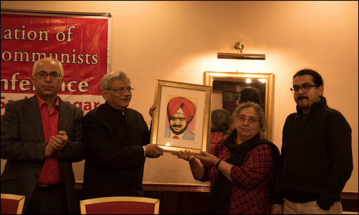 At National Conference of AIC presenting a portrait of Late Com. Avtar Singh Sadiq to Com